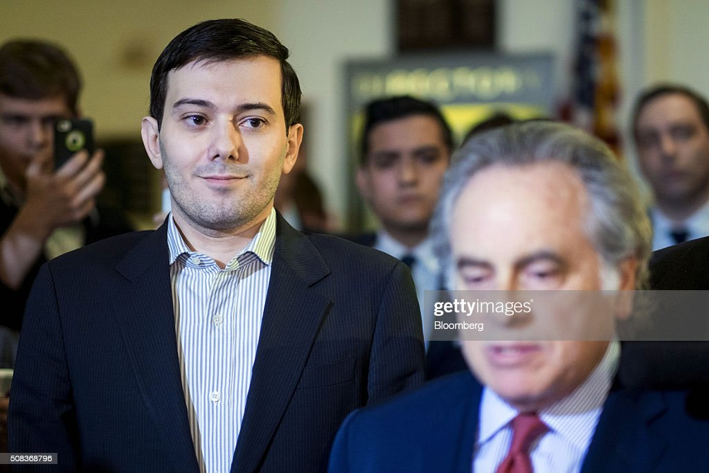 <a gi-track='captionPersonalityLinkClicked' href=/galleries/search?phrase=Martin+Shkreli&family=editorial&specificpeople=8043643 ng-click='$event.stopPropagation()'>Martin Shkreli</a>, former chief executive officer of Turing Pharmaceuticals LLC, left, smiles as his attorney <a gi-track='captionPersonalityLinkClicked' href=/galleries/search?phrase=Benjamin+Brafman&family=editorial&specificpeople=2776479 ng-click='$event.stopPropagation()'>Benjamin Brafman</a> speaks to the media after a House Committee on Oversight and Government Reform hearing on prescription drug prices in Washington, D.C., U.S., on Thursday, Feb. 4, 2016. Shkreli, who is no longer with Turing and faces federal fraud charges unrelated to the drugmaker, declined to make any comments to the committee. 'On the advice of counsel, I invoke my Fifth Amendment,' Shkreli said. Photographer: Pete Marovich/Bloomberg via Getty Images