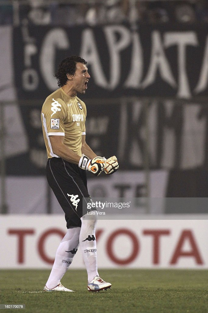 <a gi-track='captionPersonalityLinkClicked' href=/galleries/search?phrase=Martin+Silva&family=editorial&specificpeople=4354248 ng-click='$event.stopPropagation()'>Martin Silva</a> goalkeeper of Olimpia celebrates during a match between Olimpia and Universidad de Chile as part of the Copa Bridgestone Libertadores 2013 at Defensores del Chaco Stadium on February 19, 2013 in Asuncion, Paraguay.
