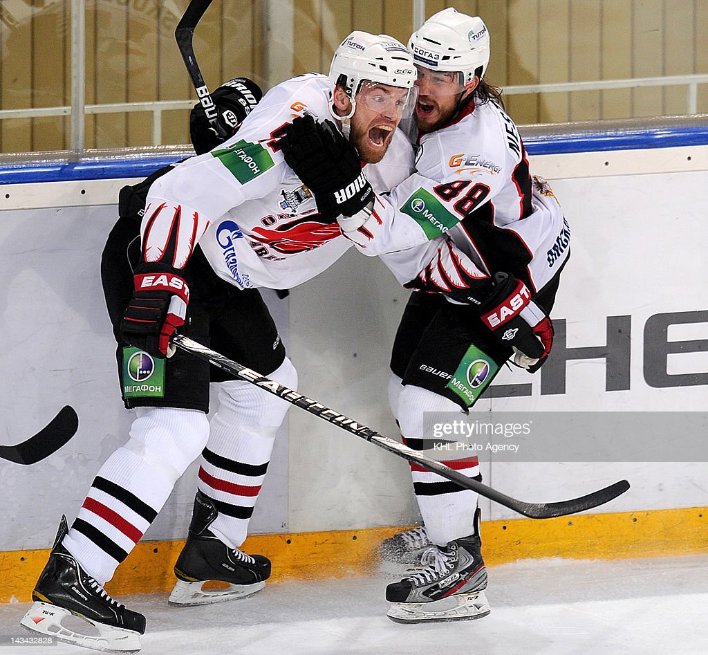 Martin Skoula #41 and Alexander Nesterov #88 of the Avangard celebrate the goal during the play-off game between Avangard Omsk region and Dinamo Moscow during the KHL Championship 2011/2012 on April 23, 2012 at the Arena Luzhniki in Moscow, Russia. The Dinamo won 2-5.