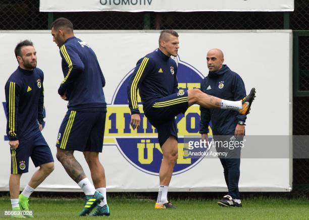 Martin Skrtel Fernandao and Matthieu Valbuena of Fenerbahce attend a training session prior to the Turkish Super Lig match between Fenerbahce and...