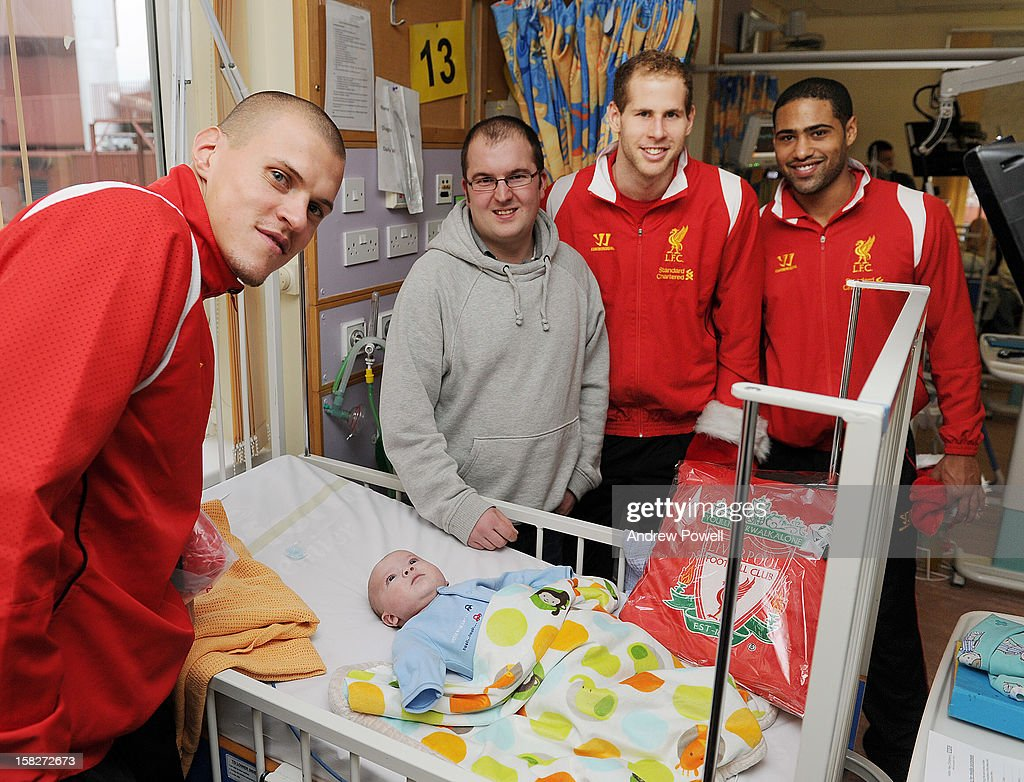 <a gi-track='captionPersonalityLinkClicked' href=/galleries/search?phrase=Martin+Skrtel&family=editorial&specificpeople=5554576 ng-click='$event.stopPropagation()'>Martin Skrtel</a>, <a gi-track='captionPersonalityLinkClicked' href=/galleries/search?phrase=Glen+Johnson&family=editorial&specificpeople=209192 ng-click='$event.stopPropagation()'>Glen Johnson</a> and <a gi-track='captionPersonalityLinkClicked' href=/galleries/search?phrase=Peter+Gulacsi&family=editorial&specificpeople=5446277 ng-click='$event.stopPropagation()'>Peter Gulacsi</a> of Liverpool FC visit Alder Hey Children's Hospital on December 12, 2012 in Liverpool, England.