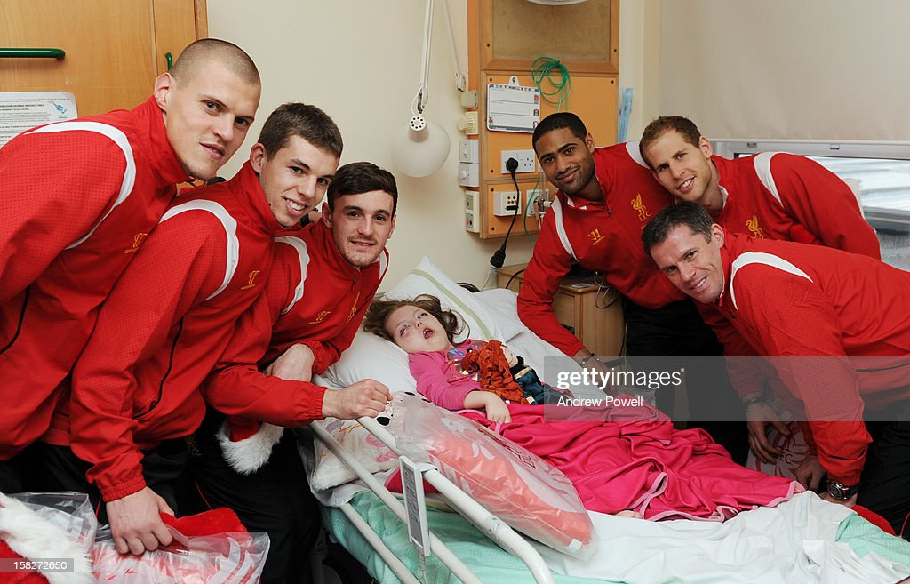 <a gi-track='captionPersonalityLinkClicked' href=/galleries/search?phrase=Martin+Skrtel&family=editorial&specificpeople=5554576 ng-click='$event.stopPropagation()'>Martin Skrtel</a>, <a gi-track='captionPersonalityLinkClicked' href=/galleries/search?phrase=Jon+Flanagan+-+Soccer+Player+-+Born+1993&family=editorial&specificpeople=8957850 ng-click='$event.stopPropagation()'>Jon Flanagan</a>, Jack Robinson, <a gi-track='captionPersonalityLinkClicked' href=/galleries/search?phrase=Glen+Johnson&family=editorial&specificpeople=209192 ng-click='$event.stopPropagation()'>Glen Johnson</a>, <a gi-track='captionPersonalityLinkClicked' href=/galleries/search?phrase=Peter+Gulacsi&family=editorial&specificpeople=5446277 ng-click='$event.stopPropagation()'>Peter Gulacsi</a> and <a gi-track='captionPersonalityLinkClicked' href=/galleries/search?phrase=Jamie+Carragher&family=editorial&specificpeople=206485 ng-click='$event.stopPropagation()'>Jamie Carragher</a> of Liverpool FC visit Alder Hey Children's Hospital on December 12, 2012 in Liverpool, England.