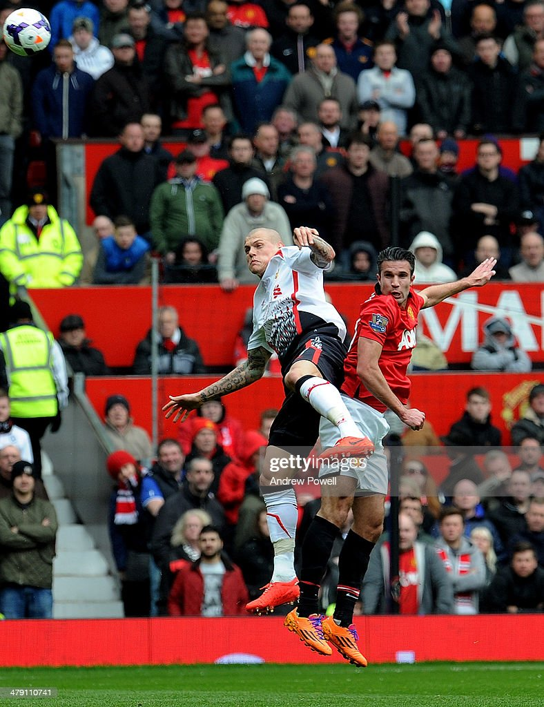 Martin Skrtel of Liverpool and Robin Van Persie of Manchester United during the Barclays Premier Leauge match between Manchester United and Liverpool at Old Trafford on March 16, 2014 in Manchester, England.