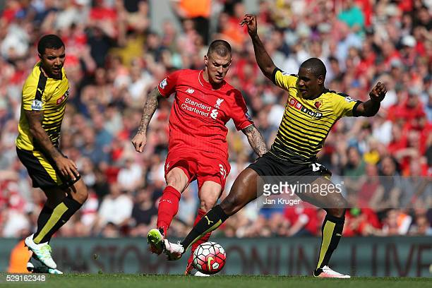 Martin Skrtel of Liverpool battles for the ball with Odion Ighalo of Watford during the Barclays Premier League match between Liverpool and Watford...