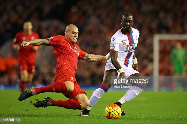 Martin Skrtel of Liverpool battles for the ball with Yannick Bolasie of Crystal Palace during the Barclays Premier League match between Liverpool and...