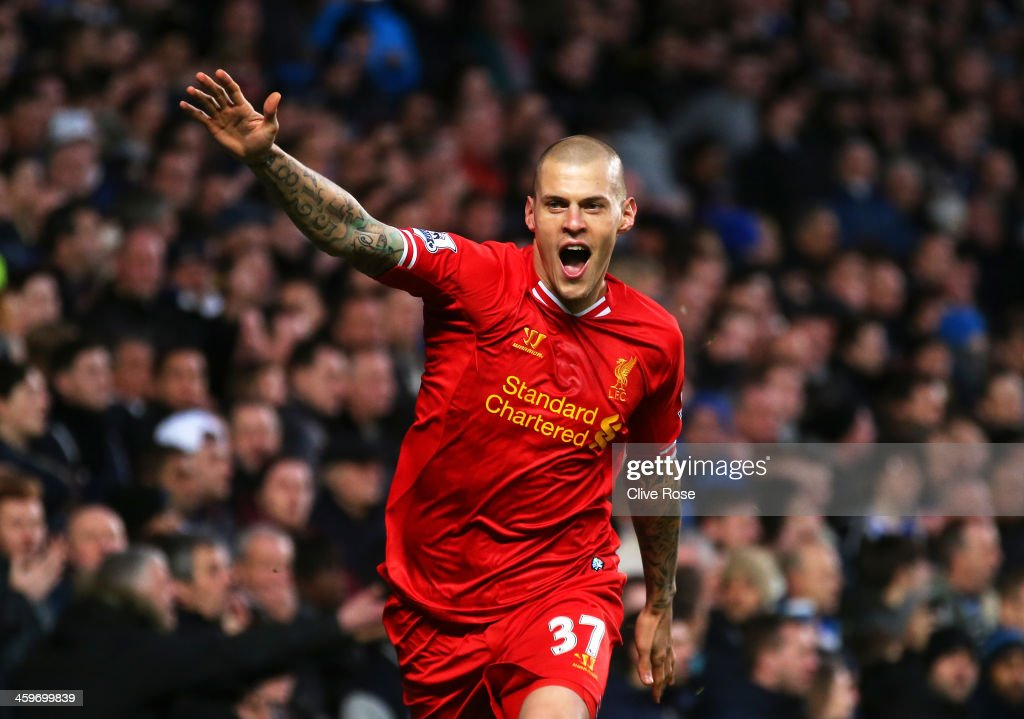<a gi-track='captionPersonalityLinkClicked' href=/galleries/search?phrase=Martin+Skrtel&family=editorial&specificpeople=5554576 ng-click='$event.stopPropagation()'>Martin Skrtel</a> of Liverpool celebrates after scoring the opening goal during the Barclays Premier League match between Chelsea and Liverpool at Stamford Bridge on December 29, 2013 in London, England.