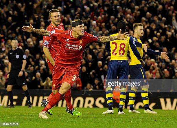 Martin Skrtel of Liverpool celebrates his goal during the Barclays Premier League match between Liverpool and Arsenal at Anfield on December 21 2014...
