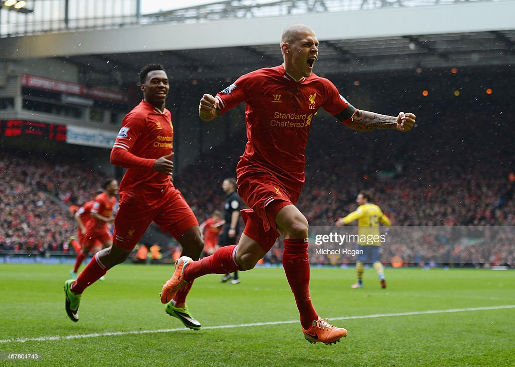 <a gi-track='captionPersonalityLinkClicked' href=/galleries/search?phrase=Martin+Skrtel&family=editorial&specificpeople=5554576 ng-click='$event.stopPropagation()'>Martin Skrtel</a> of Liverpool celebrates scoring the opening goal during the Barclays Premier League match between Liverpool and Arsenal at Anfield on February 8, 2014 in Liverpool, England.