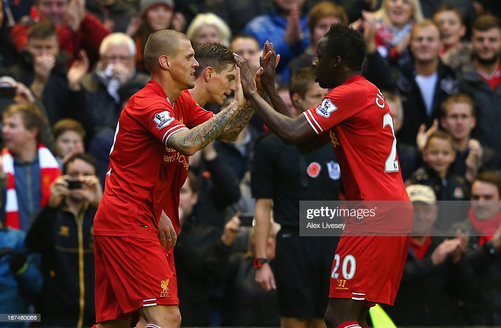 <a gi-track='captionPersonalityLinkClicked' href=/galleries/search?phrase=Martin+Skrtel&family=editorial&specificpeople=5554576 ng-click='$event.stopPropagation()'>Martin Skrtel</a> of Liverpool celebrates scoring the second goal with his team-mate <a gi-track='captionPersonalityLinkClicked' href=/galleries/search?phrase=Aly+Cissokho&family=editorial&specificpeople=4302605 ng-click='$event.stopPropagation()'>Aly Cissokho</a> (r) during the Barclays Premier League match between Liverpool and Fulham at Anfield on November 9, 2013 in Liverpool, England.