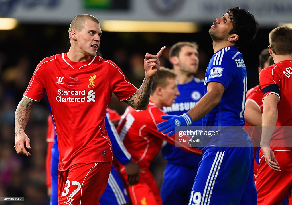 Martin Skrtel of Liverpool clashes with Diego Costa of Chelsea during the Capital One Cup SemiFinal second leg between Chelsea and Liverpool at...