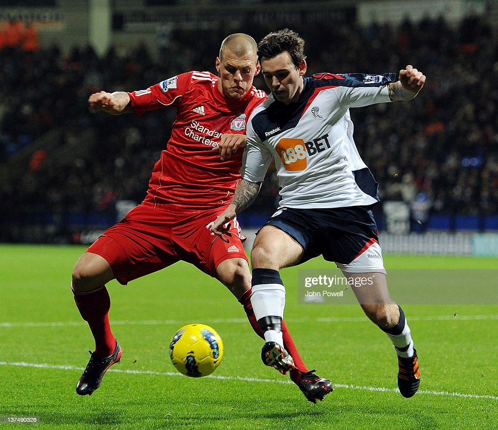 <a gi-track='captionPersonalityLinkClicked' href=/galleries/search?phrase=Martin+Skrtel&family=editorial&specificpeople=5554576 ng-click='$event.stopPropagation()'>Martin Skrtel</a> of Liverpool competes with Mark Davies of Bolton Wanderers during the Barclays Premier League match between Bolton Wanderers and Liverpool at Reebok Stadium on January 21, 2012 in Bolton, England.