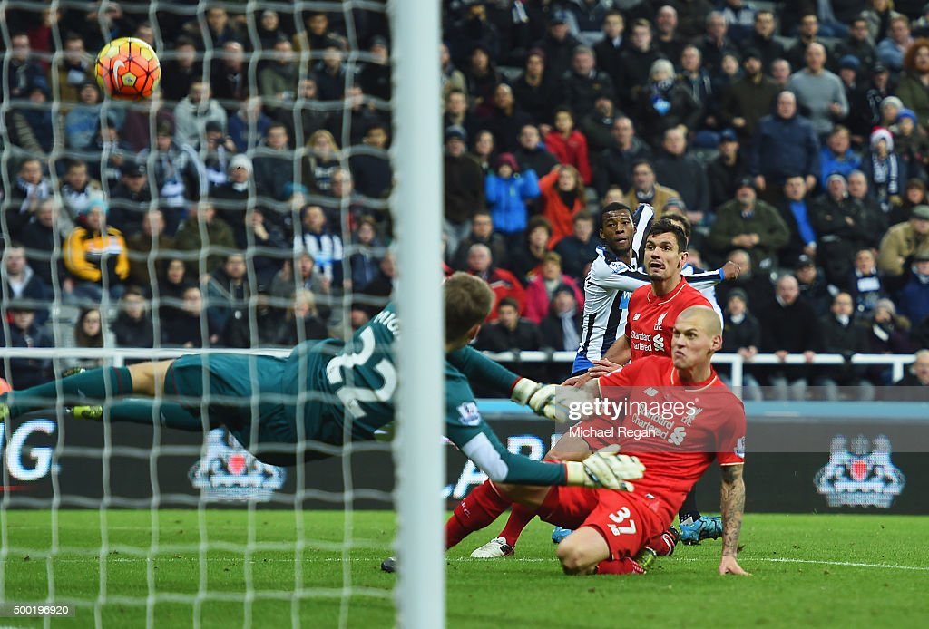 Martin Skrtel of Liverpool (37) deflects a cross from Georginio Wijnaldum of Newcastle United (3R) past goalkeeper Simon Mignolet of Liverpool for an own goal and Newcastle's first during the Barclays Premier League match between Newcastle United and Liverpool at St James' Park on December 6, 2015 in Newcastle upon Tyne, England