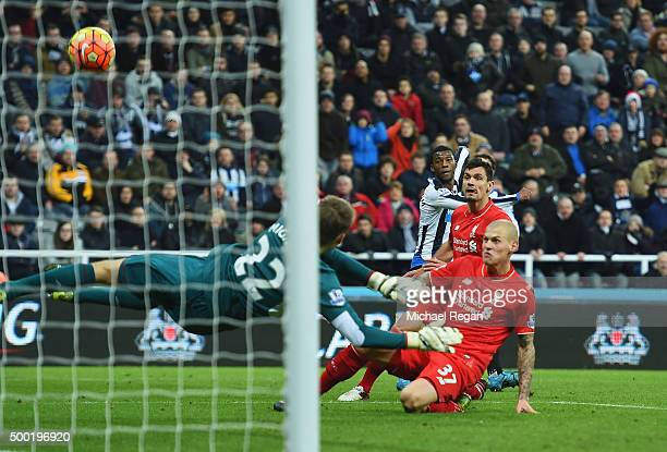 Martin Skrtel of Liverpool deflects a cross from Georginio Wijnaldum of Newcastle United past goalkeeper Simon Mignolet of Liverpool for an own goal...