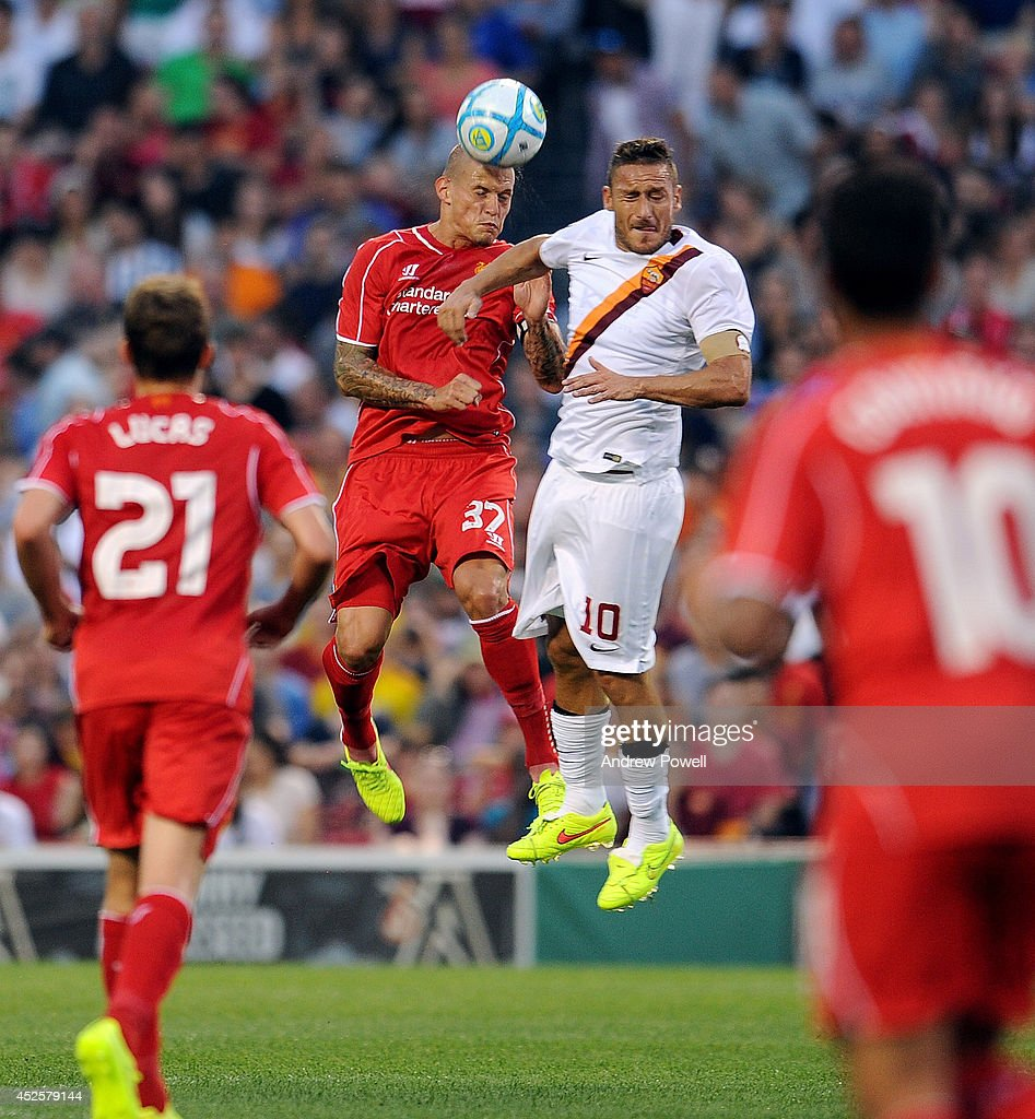 Martin Skrtel of Liverpool goes up with Francesco Totti of AS Roma during the pre season friendly match between Liverpool FC and AS Roma at Fenway Park on July 23, 2014 in Boston, Massachusetts.