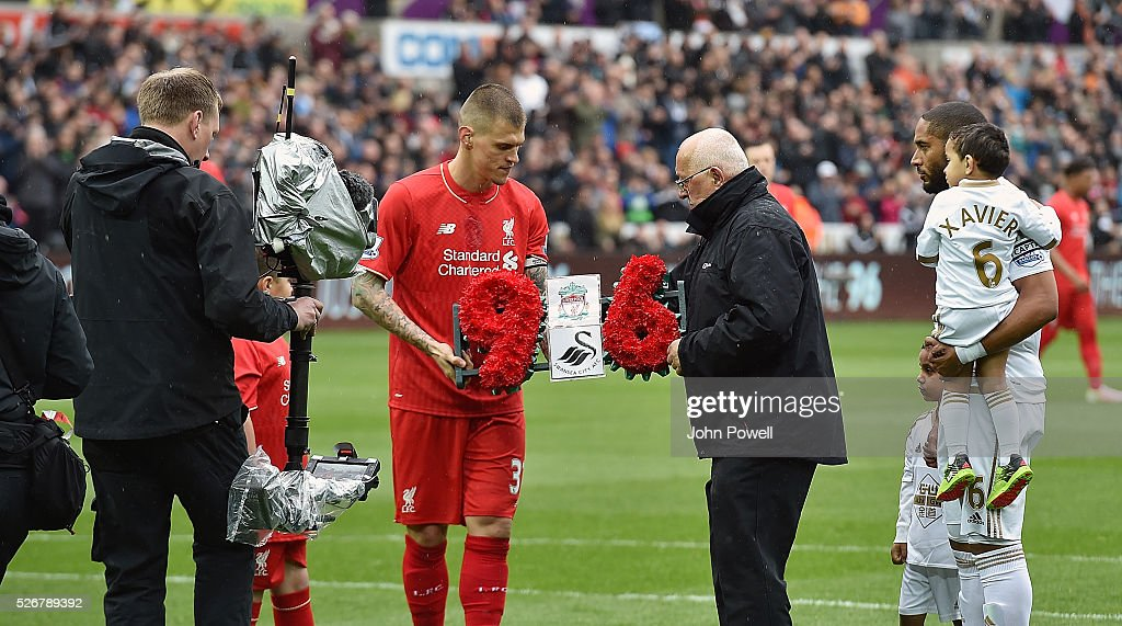 <a gi-track='captionPersonalityLinkClicked' href=/galleries/search?phrase=Martin+Skrtel&family=editorial&specificpeople=5554576 ng-click='$event.stopPropagation()'>Martin Skrtel</a> of Liverpool hands over a wreath to Barry Devonside, father of Hillsborough victim Christopher Devonside as the teams remember the 96 victims of the Hillsborough disaster during a Premier League match between Swansea City and Liverpool at the Liberty Stadium on May 01, 2016 in Swansea, Wales.