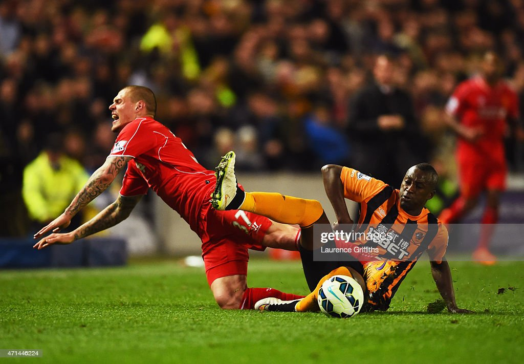Martin Skrtel of Liverpool is challenged by Dame N'Doye of Hull City during the Barclays Premier League match between Hull City and Liverpool at KC Stadium on April 28, 2015 in Hull, England.