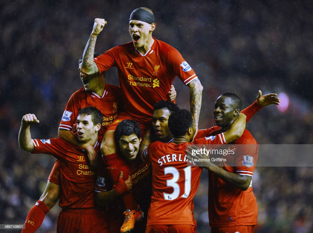 <a gi-track='captionPersonalityLinkClicked' href=/galleries/search?phrase=Martin+Skrtel&family=editorial&specificpeople=5554576 ng-click='$event.stopPropagation()'>Martin Skrtel</a> of Liverpool jumps on the shoulders of <a gi-track='captionPersonalityLinkClicked' href=/galleries/search?phrase=Daniel+Sturridge&family=editorial&specificpeople=677270 ng-click='$event.stopPropagation()'>Daniel Sturridge</a> (2nd R) after the third goal during during the Barclays Premier League match between Liverpool and Everton at Anfield on January 28, 2014 in Liverpool, England.