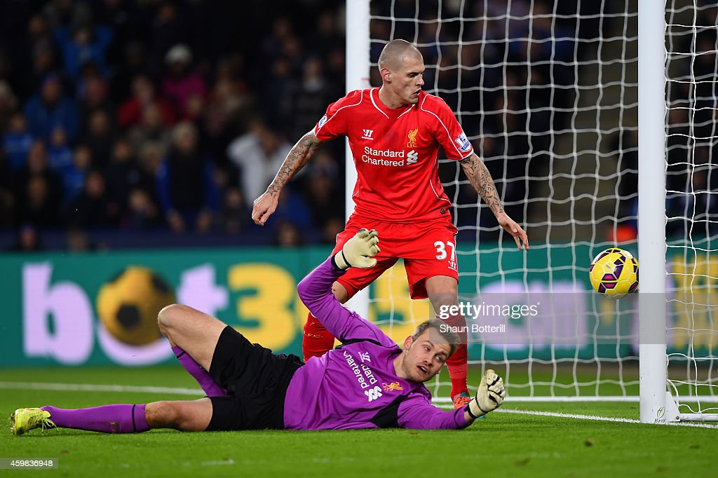 <a gi-track='captionPersonalityLinkClicked' href=/galleries/search?phrase=Martin+Skrtel&family=editorial&specificpeople=5554576 ng-click='$event.stopPropagation()'>Martin Skrtel</a> of Liverpool looks on as <a gi-track='captionPersonalityLinkClicked' href=/galleries/search?phrase=Simon+Mignolet&family=editorial&specificpeople=7124442 ng-click='$event.stopPropagation()'>Simon Mignolet</a> of Liverpool scores an own goal during the Barclays Premier League match between Leicester City and Liverpool at The King Power Stadium on December 2, 2014 in Leicester, England.