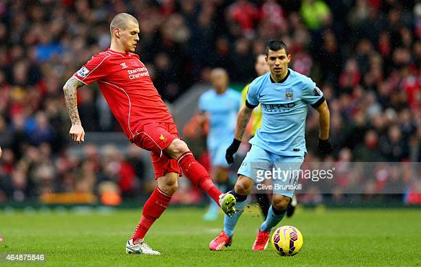 Martin Skrtel of Liverpool passes the ball away from Sergio Aguero of Manchester City during the Barclays Premier League match between Liverpool and...