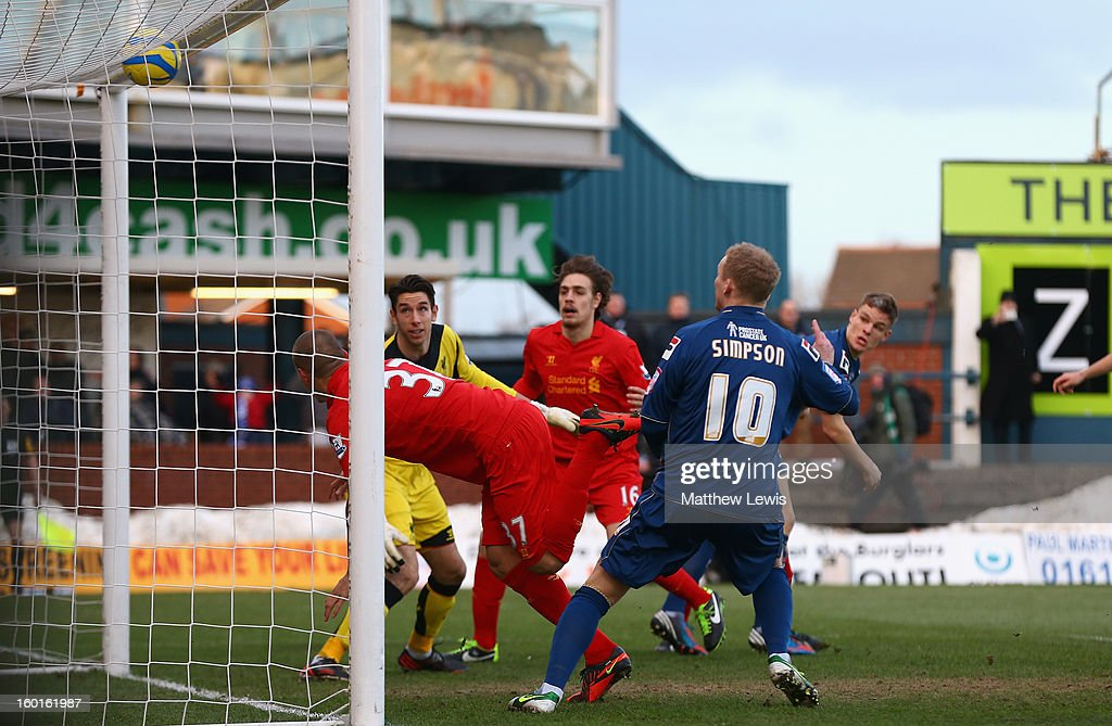 <a gi-track='captionPersonalityLinkClicked' href=/galleries/search?phrase=Martin+Skrtel&family=editorial&specificpeople=5554576 ng-click='$event.stopPropagation()'>Martin Skrtel</a> of Liverpool scores an own goal during the FA Cup with Budweiser Fourth Round match between Oldham Athletic and Liverpool at Boundary Park on January 27, 2013 in Oldham, England.
