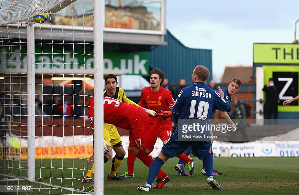 Martin Skrtel of Liverpool scores an own goal during the FA Cup with Budweiser Fourth Round match between Oldham Athletic and Liverpool at Boundary...