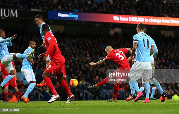 Martin Skrtel of Liverpool scores his team's fourth goal during the Barclays Premier League match between Manchester City and Liverpool at Etihad...