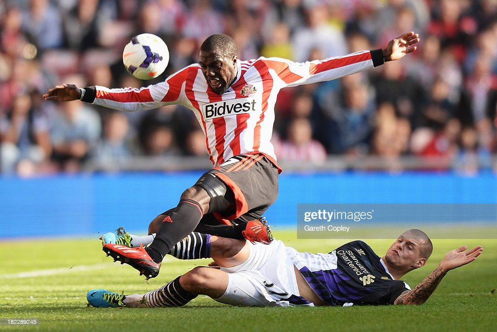 <a gi-track='captionPersonalityLinkClicked' href=/galleries/search?phrase=Martin+Skrtel&family=editorial&specificpeople=5554576 ng-click='$event.stopPropagation()'>Martin Skrtel</a> of Liverpool tackles <a gi-track='captionPersonalityLinkClicked' href=/galleries/search?phrase=Jozy+Altidore&family=editorial&specificpeople=4234131 ng-click='$event.stopPropagation()'>Jozy Altidore</a> of Sunderland during the Barclays Premier League match between Sunderland and Liverpool at the Stadium of Light on September 29, 2013 in Sunderland, England.