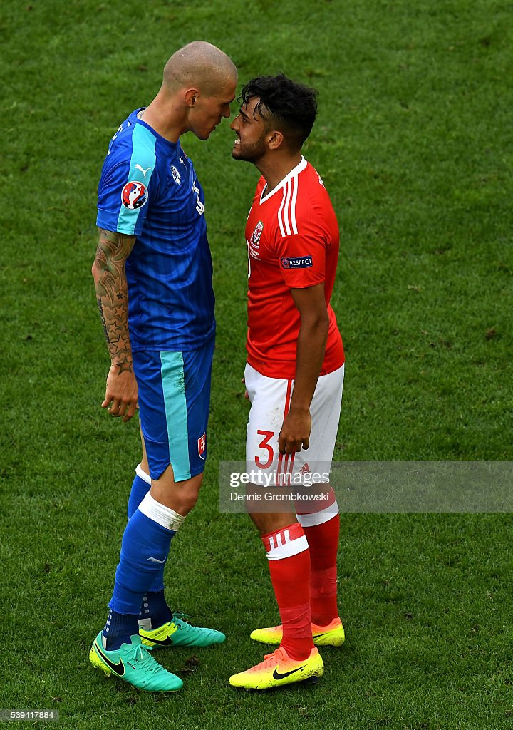 Martin Skrtel of Slovakia and Neil Taylor of Wales face off during the UEFA EURO 2016 Group B match between Wales and Slovakia at Stade Matmut Atlantique on June 11, 2016 in Bordeaux, France.