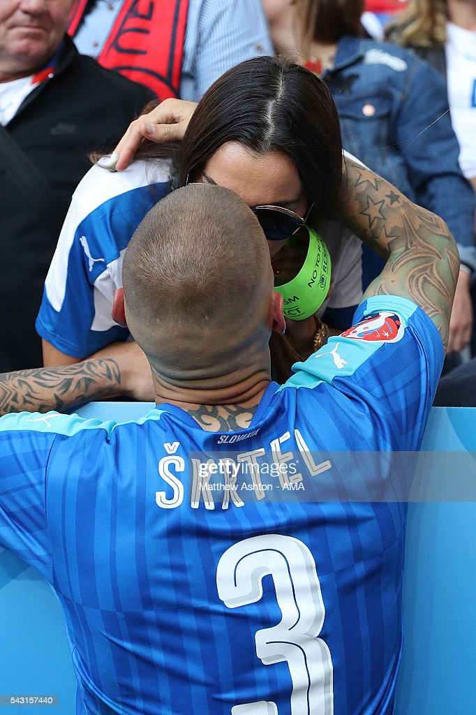 <a gi-track='captionPersonalityLinkClicked' href=/galleries/search?phrase=Martin+Skrtel&family=editorial&specificpeople=5554576 ng-click='$event.stopPropagation()'>Martin Skrtel</a> of Slovakia is consoled by his wife Barbora Lovasova at the end of the UEFA Euro 2016 Round of 16 match between Germany and Slovakia at Stade Pierre-Mauroy on June 26, 2016 in Lille, France.