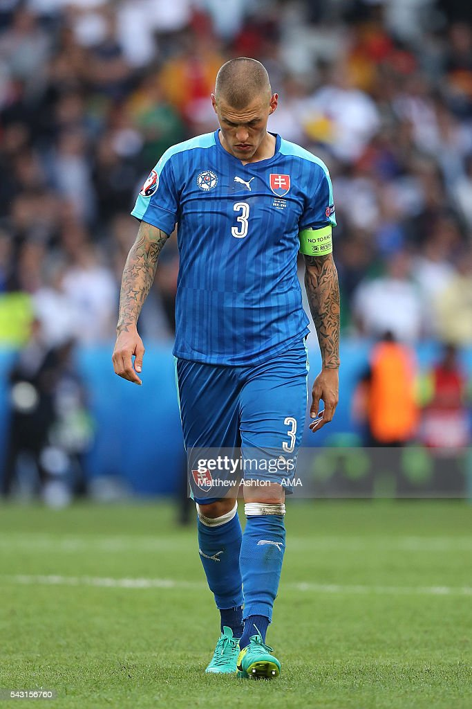 <a gi-track='captionPersonalityLinkClicked' href=/galleries/search?phrase=Martin+Skrtel&family=editorial&specificpeople=5554576 ng-click='$event.stopPropagation()'>Martin Skrtel</a> of Slovakia looks dejected at the end of the UEFA Euro 2016 Round of 16 match between Germany and Slovakia at Stade Pierre-Mauroy on June 26, 2016 in Lille, France.