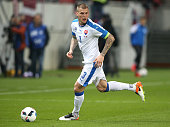 Martin Skrtel of Slovakia runs with the ball during the international friendly match between Slovakia and Latvia held at Stadion Antona Malatinskeho...