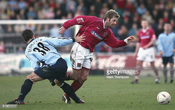 Martin Smith of Northampton is tackled by Jamie Redknapp of Southampton during the FA Cup Third Round match between Northampton Town and Southampton...