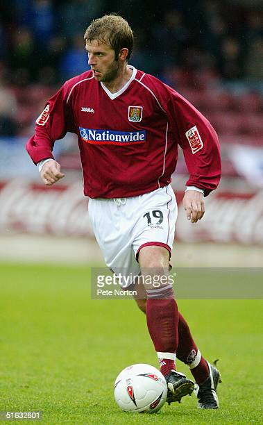 Martin Smith of Northampton Town in action during the Coca Cola League Two match Northampton Town v Rochdale held at the Sixfields Stadium...