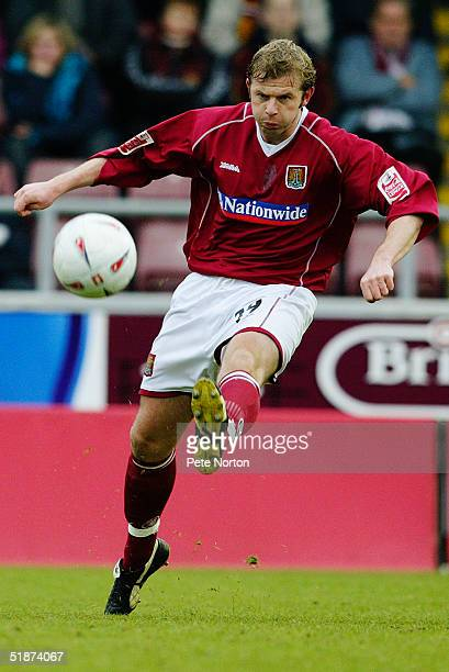 Martin Smith of Northampton Town in action during the FA Cup 2nd round match between Northampton Town and Bury held at the Sixfields Stadium...
