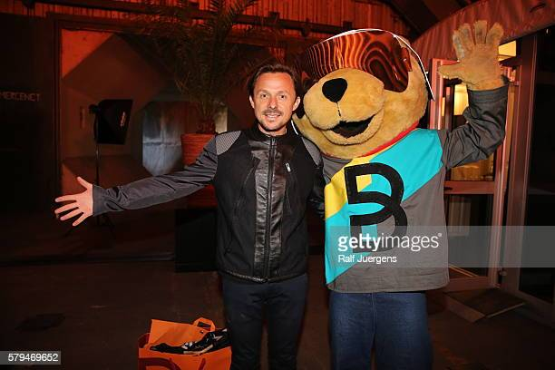 Martin Solveig and BreuniBaer mascot of Breuninger pose for a photograph at the ParookaVille Festival on July 15 2016 in Weeze Germany