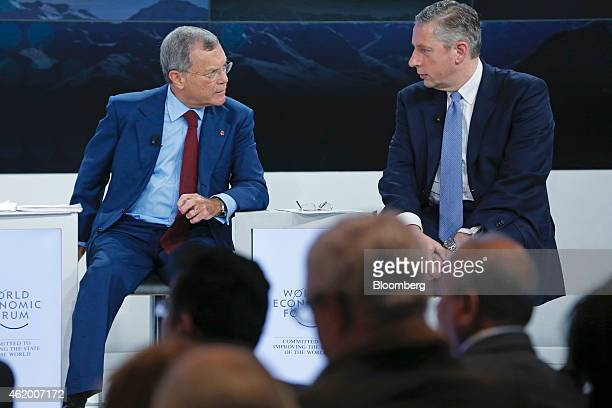 Martin Sorrell chief executive officer of WPP Plc left speaks to Klaus Kleinfeld chief executive officer of Alcoa Inc during a session on day three...