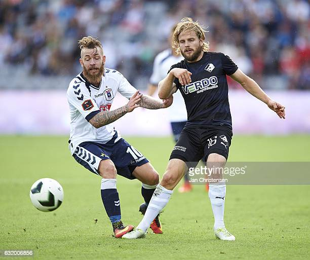 Martin Spelmann of AGF Arhus and Kasper Fisker of Randers FC compete for the ball during the Danish Alka Superliga match between AGF Arhus and...