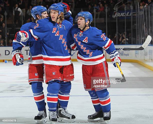 Martin St Louis Carl Hagelin and Matt Hunwick of the New York Rangers celebrate after a third period goal against the St Louis Blues at Madison...