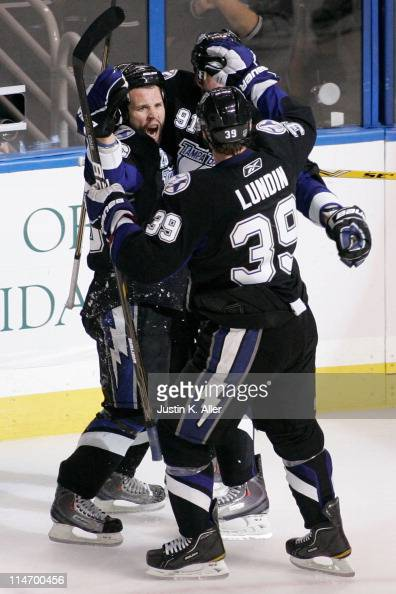 Martin St Louis celebrates his third period goal with Steven Stamkos and Mike Lundin of the Tampa Bay Lightning in Game Six of the Eastern Conference...