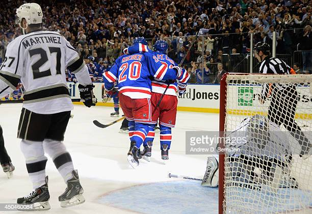 Martin St Louis of the New York Rangers celebrates his goal against Jonathan Quick of the Los Angeles Kings with teammates during the second period...