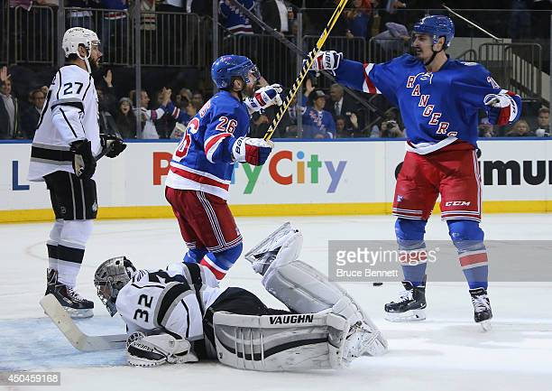 Martin St Louis of the New York Rangers celebrates his goal on Jonathan Quick of the Los Angeles Kings with Chris Kreider of the New York Rangers...
