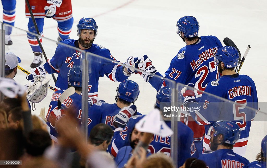 Martin St. Louis #26 of the New York Rangers celebrates his goal on Jonathan Quick #32 of the Los Angeles Kings with his teammates at the bench during the second period of Game Four of the 2014 NHL Stanley Cup Final at Madison Square Garden on June 11, 2014 in New York, New York.