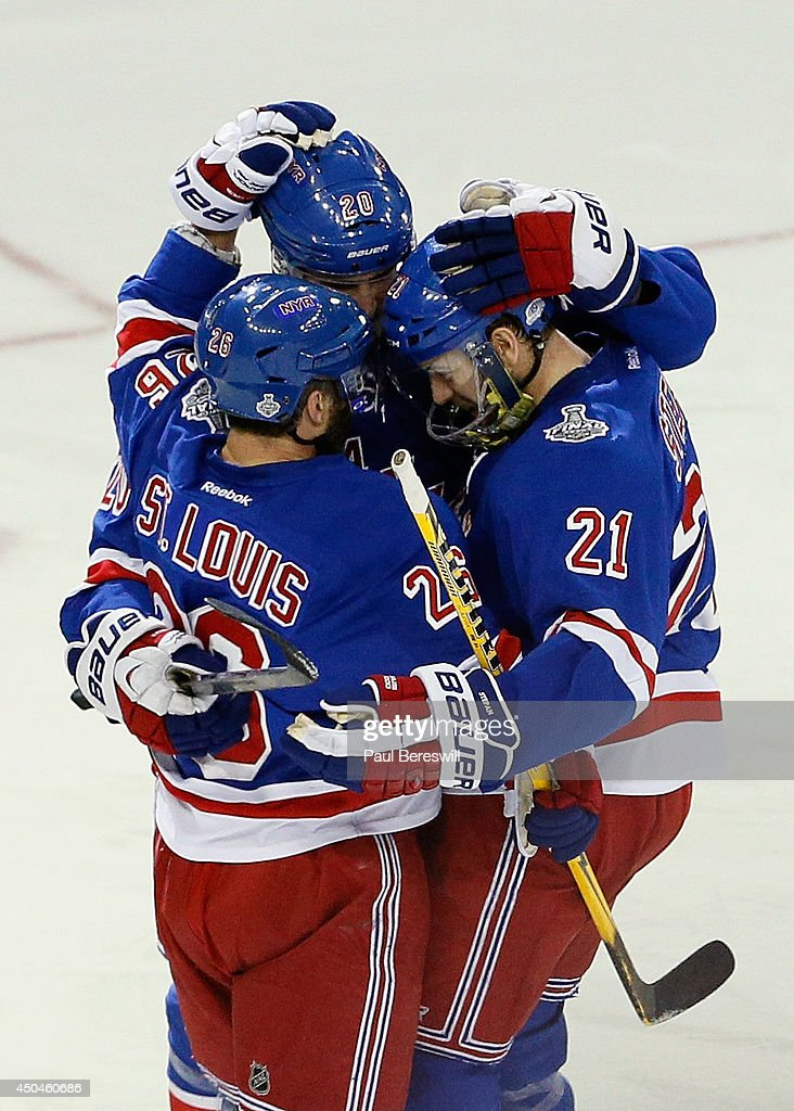 Martin St. Louis #26 of the New York Rangers celebrates his goal on Jonathan Quick #32 of the Los Angeles Kings with Chris Kreider #20 and Derek Stepan #21 of the New York Rangers during the second period of Game Four of the 2014 NHL Stanley Cup Final at Madison Square Garden on June 11, 2014 in New York, New York.