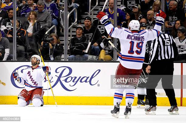 Martin St Louis of the New York Rangers celebrates his second period goal with teammate Brad Richards against the Los Angeles Kings during Game Two...