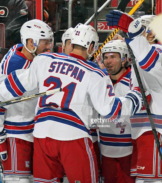 Martin St Louis of the New York Rangers celebrates his second period powerplay goal against the Philadelphia Flyers with teammates Kevin Klein Derek...