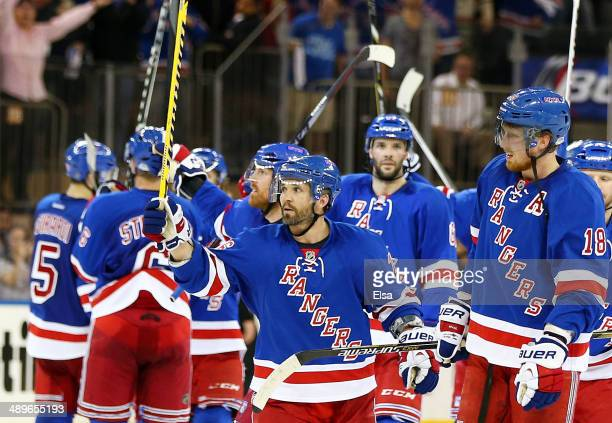 Martin St Louis of the New York Rangers celebrates their 3 to 1 win over the Pittsburgh Penguins with teammates in Game Six of the Second Round of...