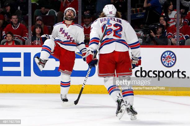 Martin St Louis of the New York Rangers celebrates with Carl Hagelin after scoring a first period goal against the Montreal Canadiens in Game One of...