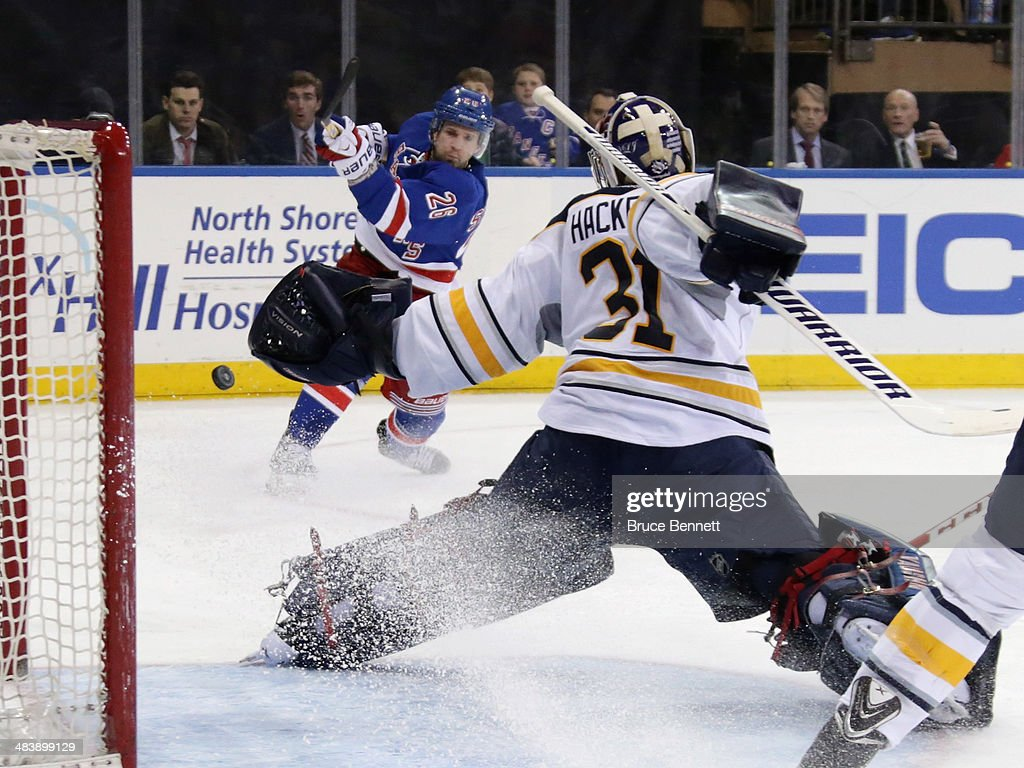 <a gi-track='captionPersonalityLinkClicked' href=/galleries/search?phrase=Martin+St.+Louis&family=editorial&specificpeople=202067 ng-click='$event.stopPropagation()'>Martin St. Louis</a> #26 of the New York Rangers is stopped by <a gi-track='captionPersonalityLinkClicked' href=/galleries/search?phrase=Matt+Hackett&family=editorial&specificpeople=4161891 ng-click='$event.stopPropagation()'>Matt Hackett</a> #31 of the Buffalo Sabres during the second period at Madison Square Garden on April 10, 2014 in New York City.