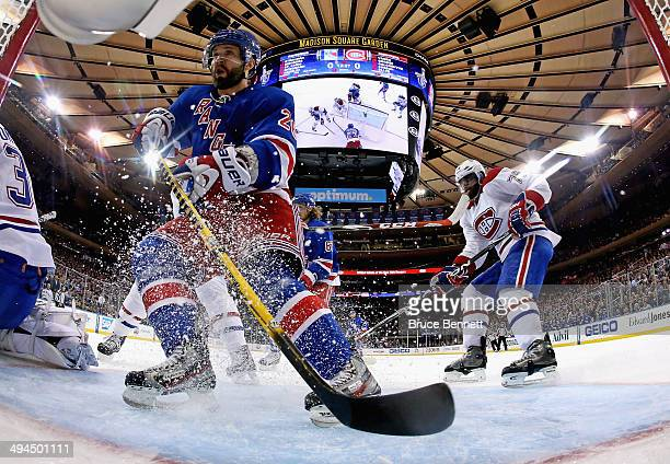 Martin St Louis of the New York Rangers keeps his eye on the puck against the Montreal Canadiens during Game Six of the Eastern Conference Final in...