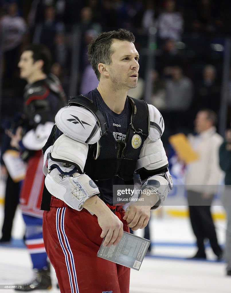 Martin St. Louis #26 of the New York Rangers leaves the ice following the last regular season home game against the Buffalo Sabres at Madison Square Garden on April 10, 2014 in New York City. The Rangers defeated the Sabres 2-1.